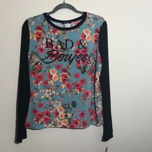 New with tag black and floral long sleeves top.